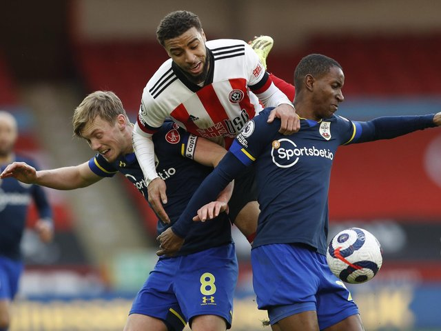 CHALLENGE: Jayden Bogle competes for the ball with Southampton's James Ward-Prowe and Ibrahima Diallo