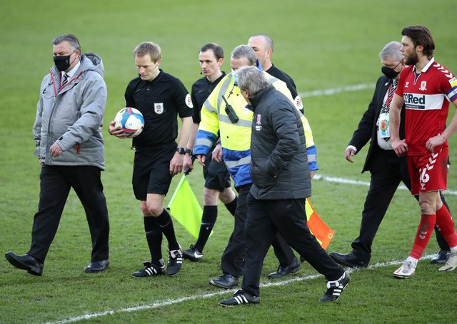 Seething: Middlesbrough manager Neil Warnock confronts referee Gavin Ward.