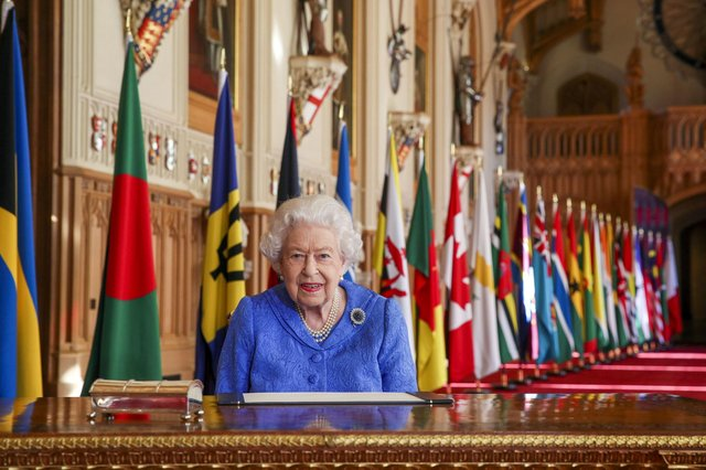 Queen Elizabeth II signs her annual Commonwealth Day Message in St George's Hall at Windsor Castle. PA Photo. Issue date: Friday March 5, 2021. Picture: Steve Parsons/PA Wire