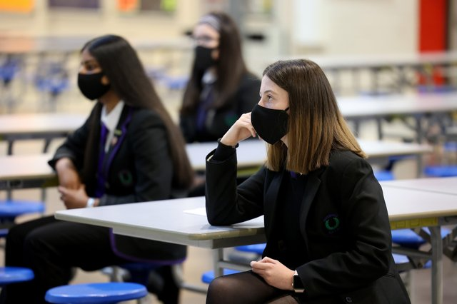 Pupils in England will be asked to wear masks in class as they return to school today. Pictured: Pupils at Rosshall Academy wear face coverings as it becomes mandatory in corridors and communal areas on August 31, 2020 in Glasgow, Scotland. (Photo by Jeff J Mitchell/Getty Images)