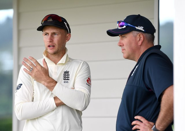IN AND OUT: England captain Joe Root speaks with coach Chris Silverwood. Picture: Gareth Copley/Getty Images.