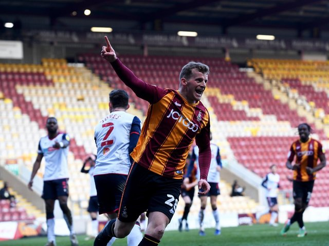 DELIGHT: Danny Rowe wheels away after scoring a stoppage-time equaliser for Bradford City. Picture: Simon Hulme.