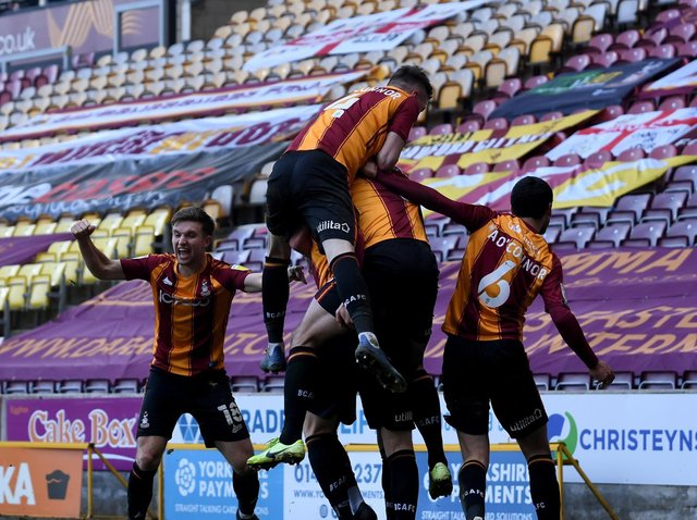 LATE DRAMA: Bradford City players celebrate their equaliser against Bolton. Picture: Simon Hulme.