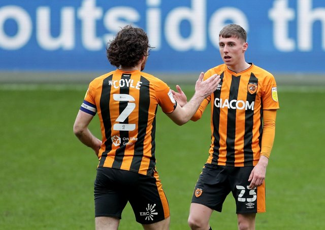 Well done: Hull City's Lewis Coyle congratulates Gavin Whyte after scoring his second goal. Picture: Richard Sellers/PA