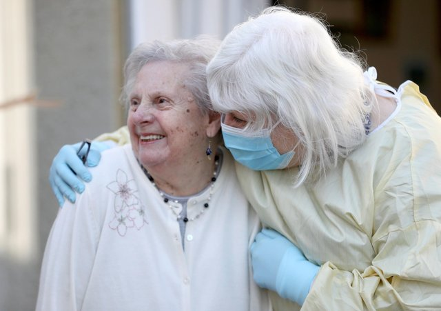 Mary Cook (left), 90, receives her first visit in three months from her daughter, Fiona Scott, at Queen's House in Kelso, in the Scottish Borders, as visiting resumes in care homes.