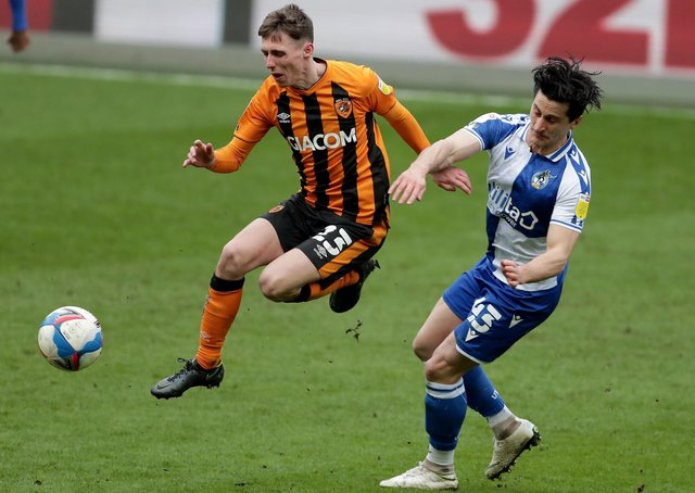 On the mark: Gavin Whyte, left, is fouled by Bristol Rovers' George Williams during a game in which his two goals helped Hull City climb to the top of League One on Saturday. (Picture: PA)