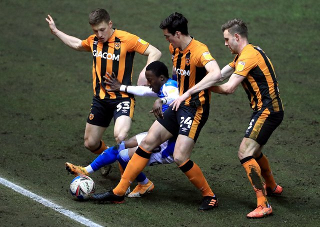 Peterborough United's Siriki Dembelel battles for the ball with Hull City's Greg Docherty (left), Jacob Greaves and Callum Elder (right). Picture: PA.