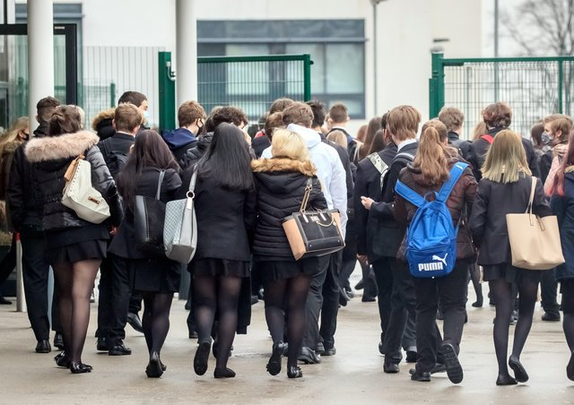 Students arrive at Outwood Academy in Woodlands, Doncaster in Yorkshire, as pupils in England return to school for the first time in two months as part of the first stage of lockdown easing.