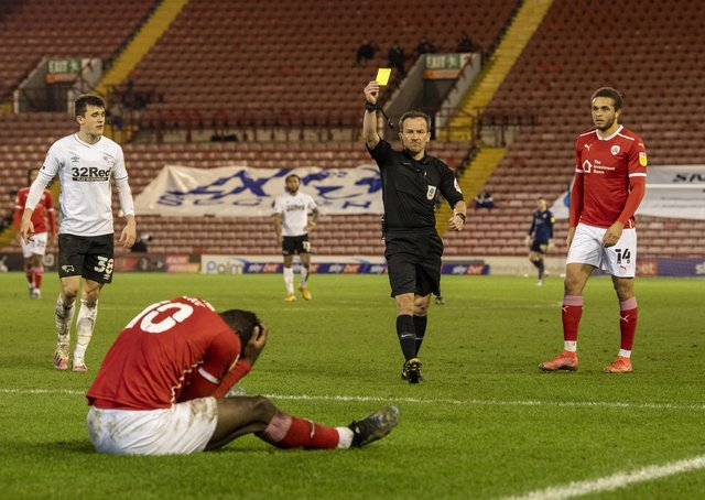 Barnsley's Daryl Dike gets a yellow card for simulation from referee Keith Stroud.   Picture: Tony Johnson
