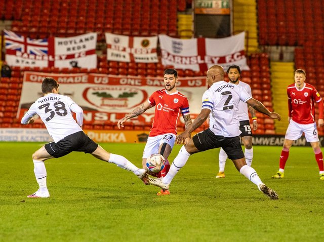 Action from Barnsley's draw with Derby with Alex Mowatt at centre stage.