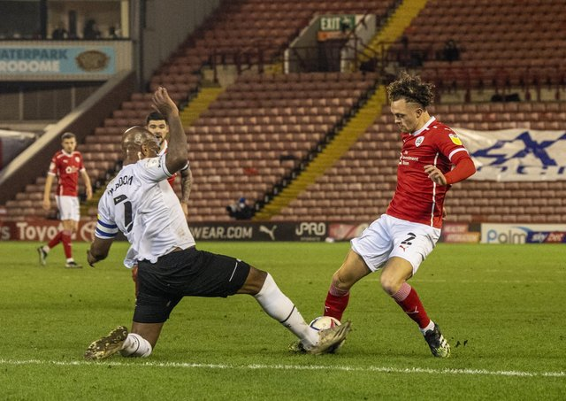 STALEMATE: Barnsley's Jordan Williams tackles Derby county's Andre Wisdom at Oakwell.  Picture: Tony Johnson