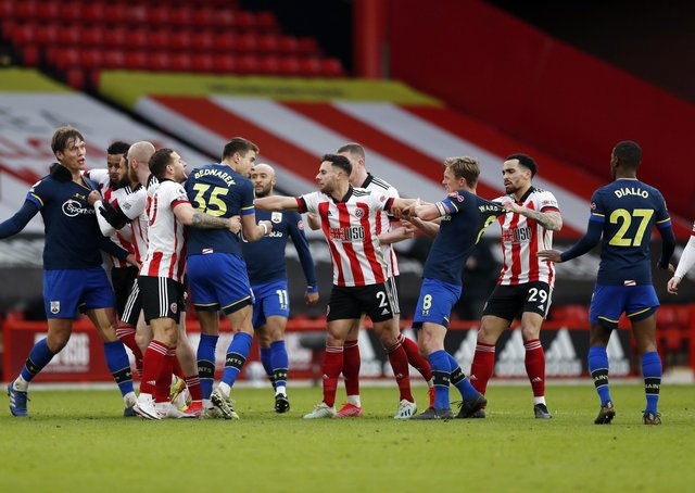 Bust-up: Tempers flare between Sheffield United and Southampton.