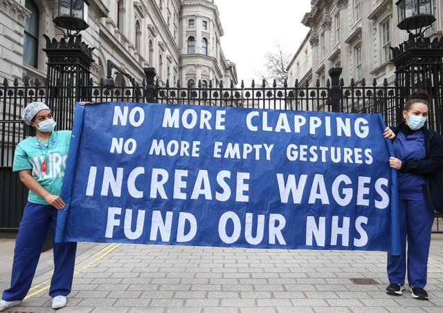 NHS staff protest outside 10 Downing Street over the proposed one per cent pay offer.
