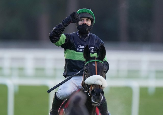 David Bass celebrates First Flow's win in the Grade One Clarence House Chase at Ascot in January.