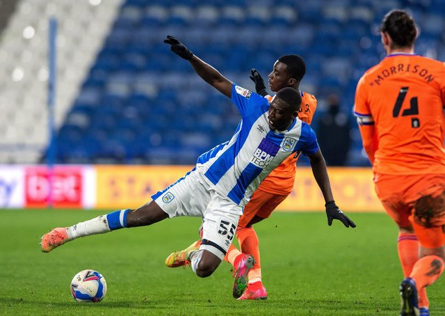 Huddersfield's Yaya Sanogo and Cardiff's Sheyo Ojo challenge for the ball.  Picture Bruce Rollinson