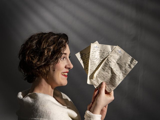 Historian Marie Woods holds love letters written at the height of WWII which were discovered under floorboards of the Esplanade Hotel, Scarborough
