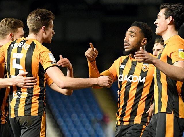 Hull City players celebrate during their midweek win over title rivals Peterborough United. Pictures: Getty Images