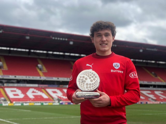 Barnsley midfielder Callum Styles with his EFL Young Player of the Month award for February. Picture courtesy of Barnsley FC.