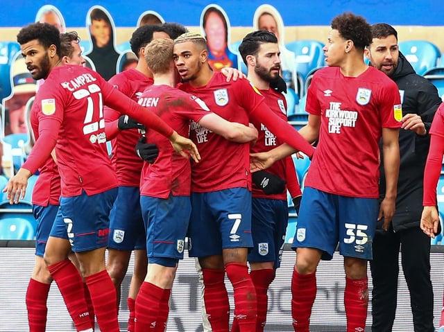 Huddersfield Town celebrate Juninho Bacuna's winning strike against QPR. Pictures: Getty Images