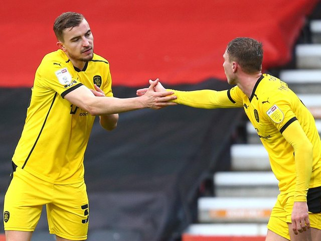 Michal Helik, left, is congratulated by Barnsley team-mate Cauley Woodrow after opening the scoring during Saturday's win at Bournemouth. Pictures: Getty Images
