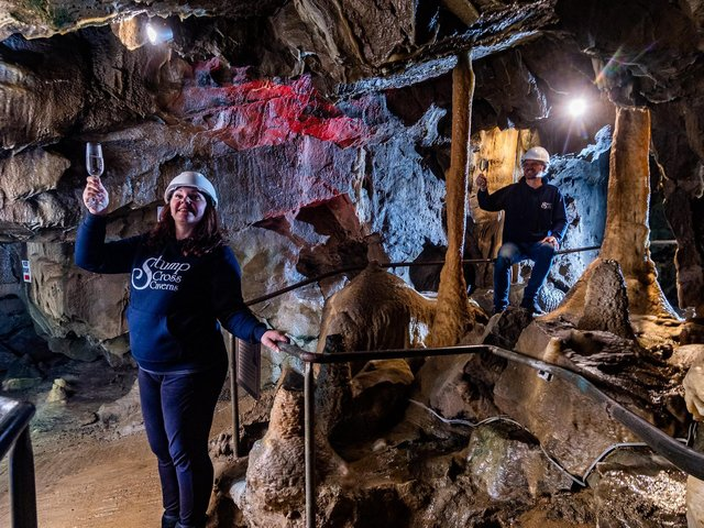 Lisa Bowerman, owner of Stumps Cross Caverns, with her partner Nick Markham, celebrating the news. Image: James Hardisty