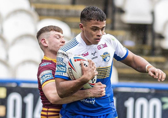 Gripped: Leeds Rhinos youngster Corey Hall is held.  Picture Tony Johnson