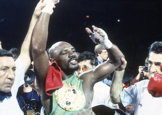 TRUE CHAMPION: Marvin Hagler celebrates after defeating Wilford Scypion for the WBA, WBC and IBF middleweight titles in May 1983, winning with a fourth round knock-out. Picture: Focus on Sport/Getty Images.