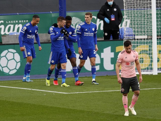 BEATEN: George Baldock trudges away as Leicester City celebrate their fifth goal