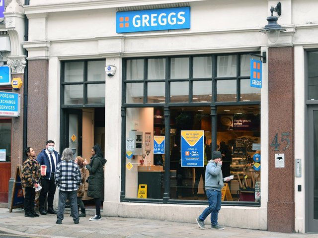 People standing around outside a Greggs in London during England's third national lockdown to curb the spread of coronaviru