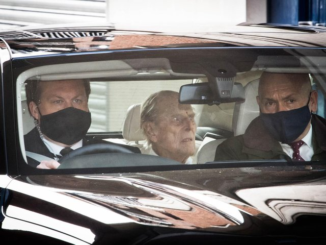 The Duke of Edinburgh (centre) is driven away in a car after leaving the King Edward VII's Hospital, London, where he has been recovering after heart surgery.