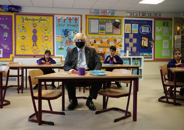 Boris Johnson during a classroom visit earlier this month prior to the reopening of the country's schools.