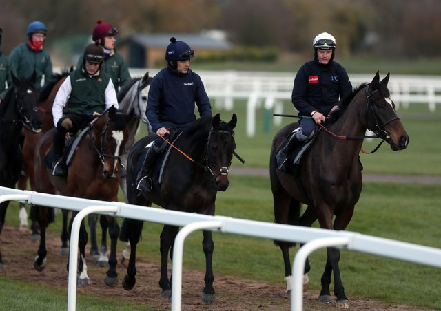 Ruby Walsh aboard Saint Sam (centre) and Paul Townend aboard Appreciate It (right) on the gallops at Cheltenham Racecourse ahead of the Cheltenham Festival  (Picture: PA)