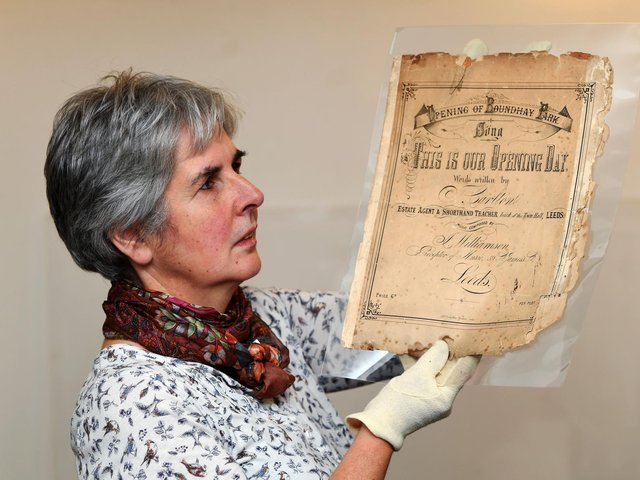 Museum curator Kitty Ross, pictured with sheet music from Leeds museums' Sounds of our City exhibition