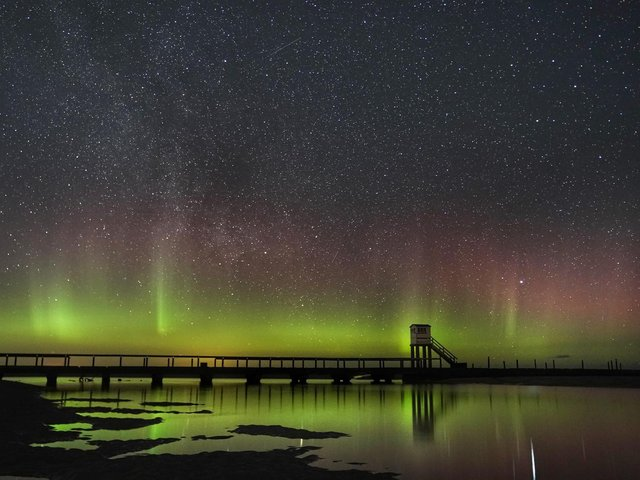 The Northern Lights above the Holy Island causeway and refuge hut