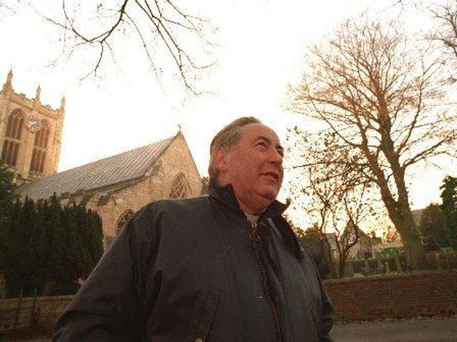 File pic: Canon Terence Grigg outside St Mary's, Cottingham