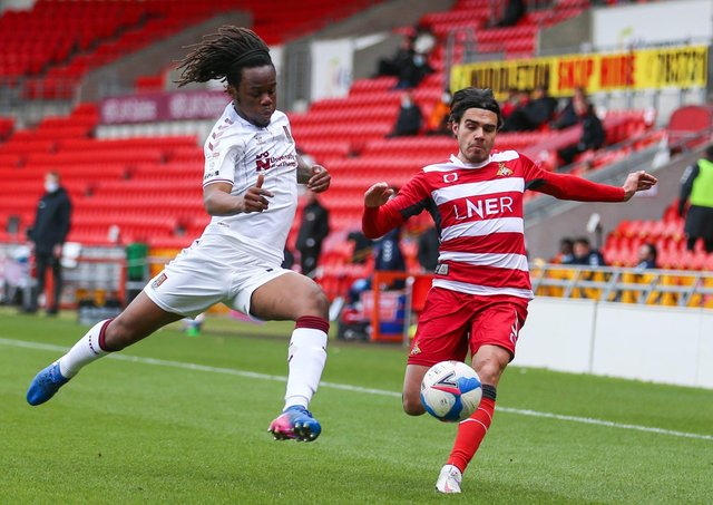 Doncaster Rovers' Reece James (right) and Northampton Town's Peter Kioso battle for the ball at the Keepmoat Stadium during Saturday's 0-0 draw.. Picture: Isaac Parkin/PA.