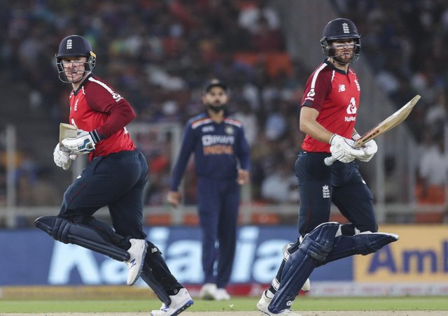England's Dawid Malan, right and Jason Roy, run between the wickets during the second Twenty20 international against India in Ahmedabad. Picture: AP/Aijaz Rahi