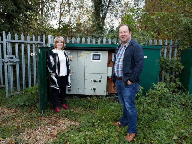Council leader Denise Jeffery and Cabinet member Matthew Morley alongside the pumping station after it was repaired last year.