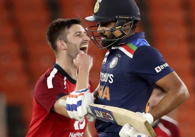England's Mark Wood, left, celebrates the wicket of India's KL Rahul, right, during the third Twenty20 cricket match between India and England at Narendra Modi Stadium in Ahmedabad, India, on Tuesday. Picture: AP Photo/Aijaz Rahi.