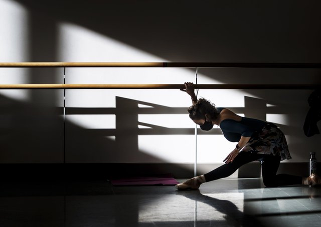 A dancer from the Northern Ballet wears a face covering during a training class at the Northern Ballet in Leeds.