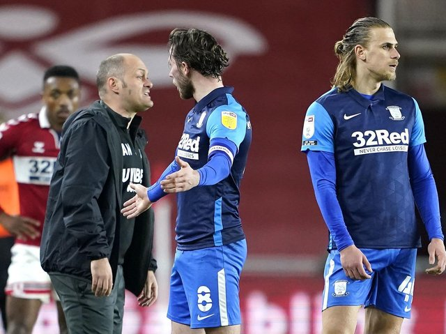 Preston midfielder Alan Browne pleads his innocence after his controversial red card at Middlesbrough, while manager Alex Neil looks furious. Picture: PA.