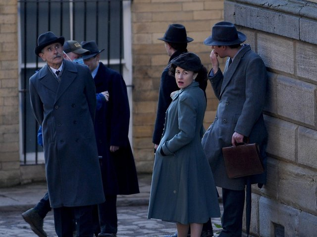Actors and extras were spotted dressed in period attire on the streets of the city.