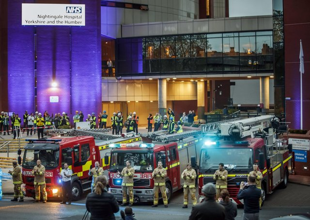 Members of the fire brigade, construction workers and members of the public, clapping outside the Nightingale Hospital at the Harrogate Convention Centre in Harrogate, to salute local heroes during a Clap for Carers NHS  celebration.