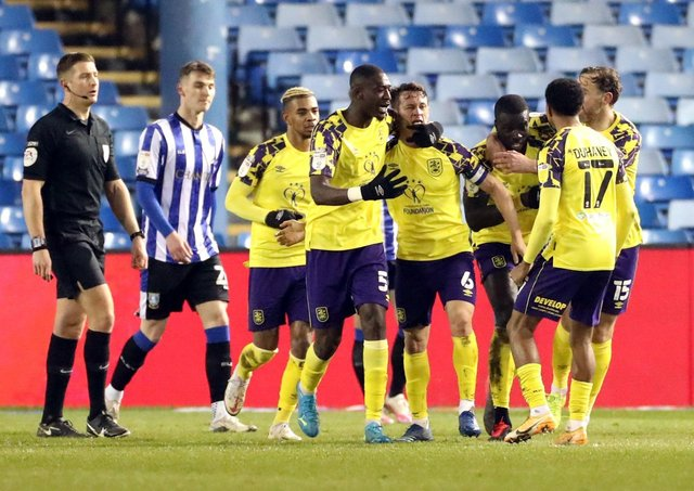 Huddersfield Town players celebrate Callum Paterson's own goal. Picture: PA.