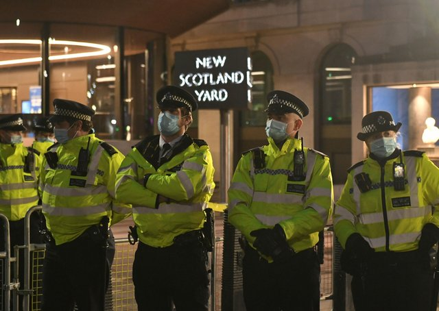 Police officers outside New Scotland Yard, central London, during a Reclaim the Streets protest in memory of Sarah Everard who went missing while walking home from a friend's flat on March 3.