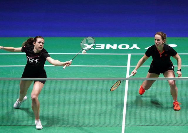 Out: England's Jenny Moore, left, and Jessica Hopton were beaten 21-18 21-7 by Malaysian pair Pearly Tan and Thinaah Muralitharan in the YONEX All England Championships. Picture: Zac Goodwin/PA Wire.