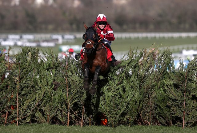 Tiger Roll and jockey Keith Donoghue clear a fence on the way to winning the Glenfarclas Chase (A Cross Country Chase) during day two of the Cheltenham Festival.