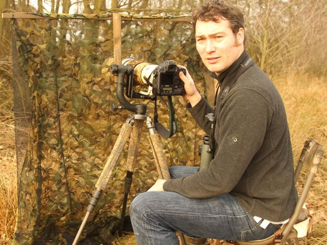 Robert Fuller with his camera photographing birds.