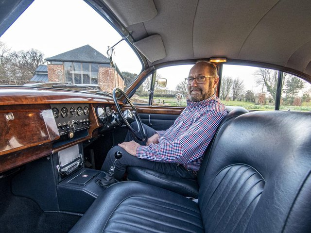 Yorkshire Post reader Jon Denton, from near Brigg in North Lincolnshire with the Jaguar car he had seen up for auction with Spicers highlighted in the paper. Picture Tony Johnson