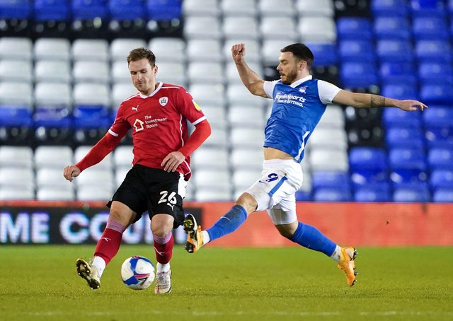 WISE HEAD: Barnsley's Michael Sollbauer, in action against Birmingham City's Scott Hogan. Picture: Zac Goodwin/PA